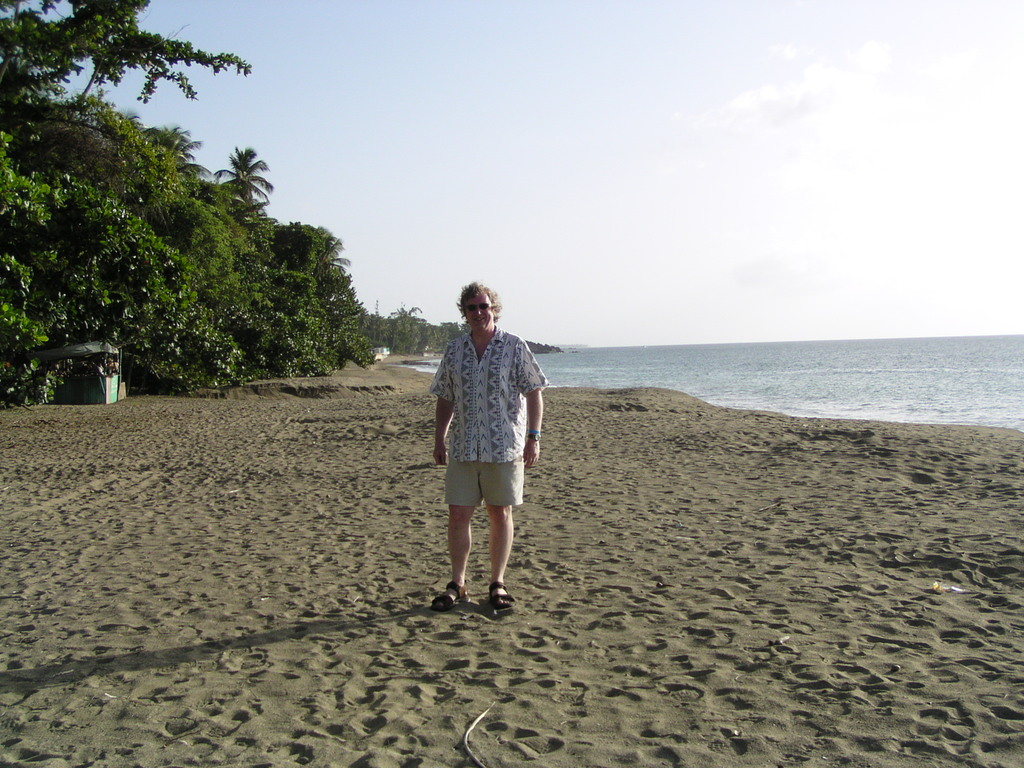 Dreadfully posed photo of Alan on Turtle Beach, Tobago